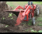tractor-lifting-full-bucket-of-soil