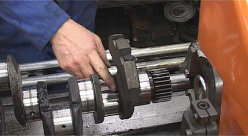 Removing crank balance weights.