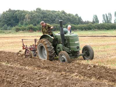 Field Marshall tractor ploughing