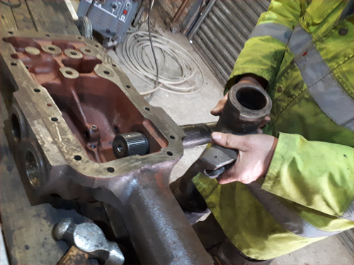 Inserting cross shaft back into hydraulic top cover of MF230 or MF240 tractor