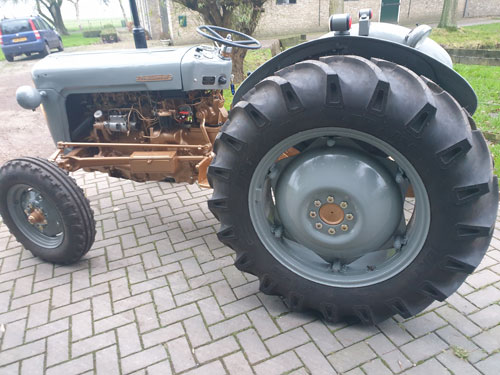 Side view of golden grey Ferguson tractor paintwork